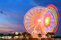 Amusement park at dusk ferris wheel in motion Stock Photo