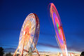 Amusement park at dusk ferris wheel in motion Stock Images