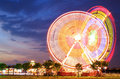 Amusement park at dusk ferris wheel in motion Royalty Free Stock Photography