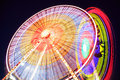 Amusement park at dusk ferris wheel in motion Royalty Free Stock Photo