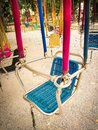 Amusement park facilities carousel metal seats in the holiday Royalty Free Stock Photo