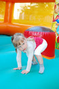 In the amusement park jumping on an inflatable slide girl summer Stock Photography