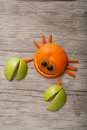 Amusing crab made of fruits on desk Royalty Free Stock Photography