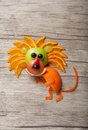 Amusing lion made of fruits on wooden background Royalty Free Stock Photos