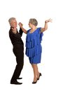 Amusing old couple dancing on a white background Stock Photo