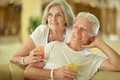 Amusing old couple on vacation drinking cocktail Stock Photo