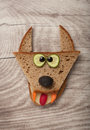 Amusing wolf made of bread on wooden background Royalty Free Stock Photography