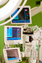 Anaesthesiolog monitors in operation surgery room with information on them with green lights on Royalty Free Stock Image