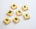 Anagram scrabble letters of s k a m e and f of the game on a plain white background Stock Photo