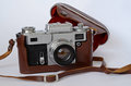 Analog camera analogue range finder in brown leather case Royalty Free Stock Image