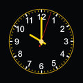 Analog clock on black background Stock Photo