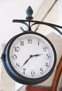 Analog clock outdoors close up. Royalty Free Stock Photo
