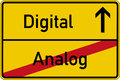Analog and digital the german words for on a road sign Royalty Free Stock Photography