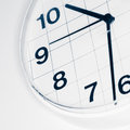 Analog wall clock narrow focus on number nine tinted black and white image Royalty Free Stock Image