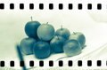Analogue film frame with apples stack on light background Stock Photography