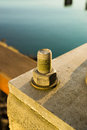 Anchor bolt up close at the pier during sunset sunrise Stock Photos