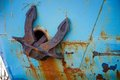 Anchor old rusty on a blue background Stock Photography