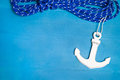 Anchor and rope on the blue wooden background Royalty Free Stock Photography