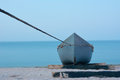 Anchored boat ashore fishing on the shore to the ocean Royalty Free Stock Images