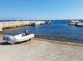 Anchored dinghy near sea with blue sky Royalty Free Stock Photo