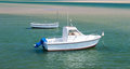 Anchored motor boat yacht in calm water Royalty Free Stock Image
