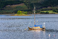 Anchored sailboat at Glencoe Royalty Free Stock Photo