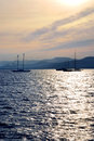 Anchored sailboats at sunset at mediterranean coast Royalty Free Stock Images