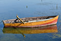Anchored yellow rowboat Royalty Free Stock Photo