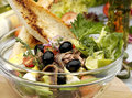 Anchovy salad w olives and french bread Royalty Free Stock Photo