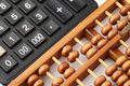 Ancient abacus and modern calculator Royalty Free Stock Photo