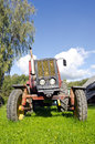 Ancient agriculture tractor in farm garden Stock Photography
