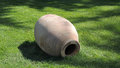 An ancient amphora on green grass in seaside park on the south coast of crimea partenit Stock Image
