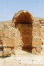 Ancient arched niche in mamshit excavations in israel stone wall with Royalty Free Stock Photo