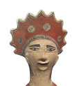 Ancient aztec head statue isolated painted clay of the of an man wearing a headdress on white Royalty Free Stock Images