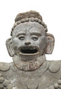Ancient aztec statue bust isolated remains of the head of an stone on white Royalty Free Stock Photo