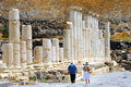 Ancient beit shean israel isr june visitors walks under pillars in on june she an is one of the most sites in Stock Photo