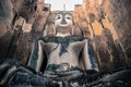 Ancient big limed t buddha an sitting in the middle of ruined church looking at us Royalty Free Stock Photography
