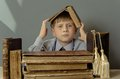 Ancient books a boy , a child Prodigy Royalty Free Stock Photo