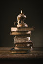 Ancient books and candle Royalty Free Stock Photo