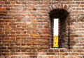 Ancient brick wall of castle with loophole as background Royalty Free Stock Photo