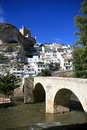 Ancient bridge and castle in Alcala del Jucar Stock Photography