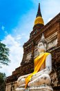 Ancient Buddha statues against blue sky at Ayutthaya, Thailand Stock Photos