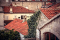 Ancient building facade in old European city with orange tile roofs with antique exterior in retro vintage style Royalty Free Stock Photo