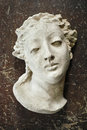 Ancient bust an old greek or roman styled sculpture of a woman on a grunge background Stock Photography