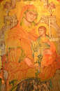 Ancient byzantine oil painting on wood of madonna and child with stunning detail of folds of cloth in tones of gold Stock Photography