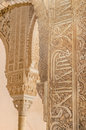 Ancient caligraphy detail in a column. Alhambra palace, Granada, Spain. Royalty Free Stock Photo