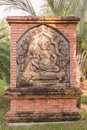 Ancient Cambodian king sculpture on brick wall Stock Photography