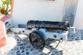 Ancient cannon on santorini island crete greece view of fira town Stock Images