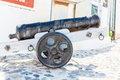 Ancient cannon on santorini island crete greece view of fira town Stock Photography