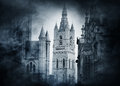 Ancient castle on a smokey background. Halloween concept. Royalty Free Stock Photo